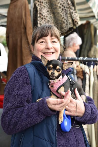 Cherille from Bezzers Biscuits with a happy customer at Hay-on-Wye